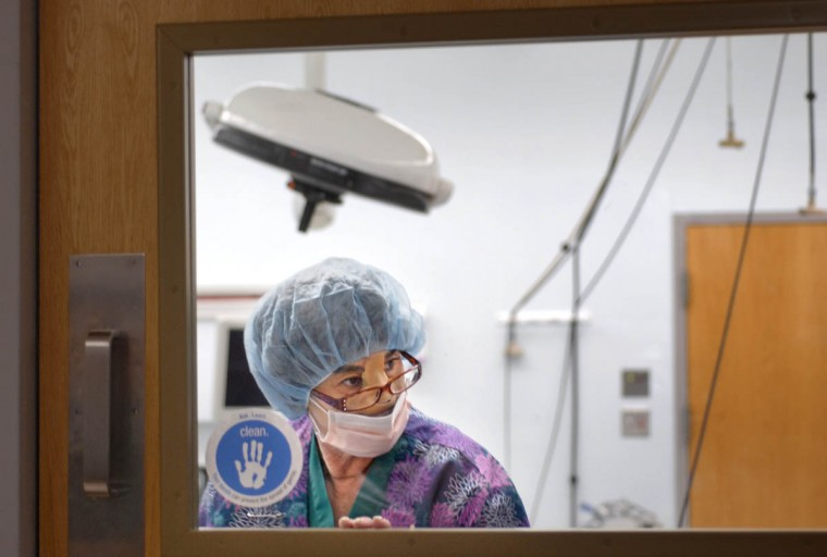 In between her own surgeries and recoveries, Linda Hershey, RN, continues to work at Lancaster Regional Medical Center. A nurse for over forty years, she's setting up an operating room at Lancaster Regional Hospital. (Algerina Perna/Baltimore Sun/Nov. 12, 2008)