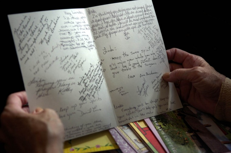 "Linda Hershey looks at a card from co-workers wishing her well. She says, ""The staff has helped me financially…. emotionally…. I couldn't ask for better co-workers."" (Algerina Perna/Baltimore Sun/June 9, 2008)"