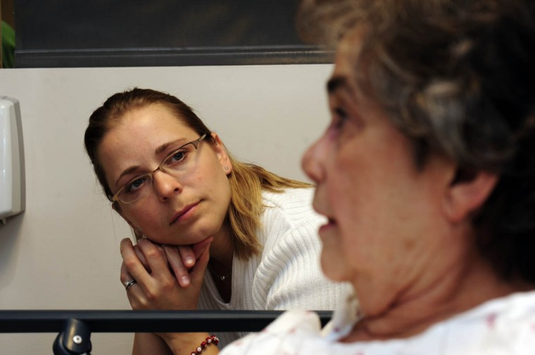 Prudence Martin, RN, Linda Hershey's friend and fellow co-worker at Lancaster Regional Medical Center, sits with Hershey before a surgery at Johns Hopkins hospital. Martin often drives Hershey to her medical appointments at Johns Hopkins. (Algerina Perna/Baltimore Sun/May 12, 2009)