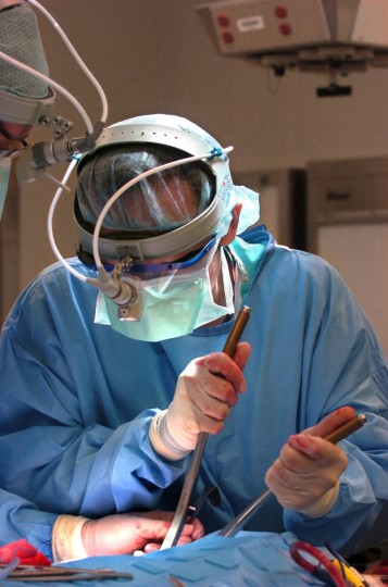 Under the supervision of Dr. Patrick J. Byrne, Johns Hopkins resident Dr. Eugene Chu, pictured, removes some of Linda Hershey's rib cartilage before it is used as part of the nose structure. (Algerina Perna/Baltimore Sun/June 17, 2008)