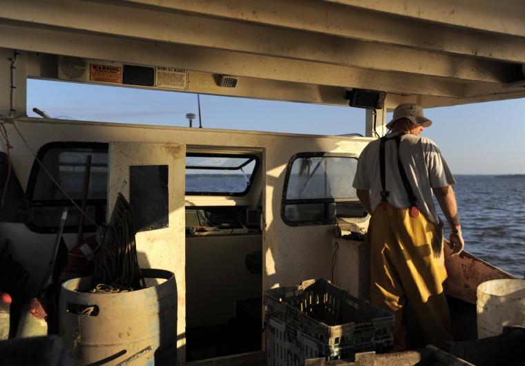 "Marcus Blake navigates ""Miss Kristi."" (Erin Kirkland/Baltimore Sun)"