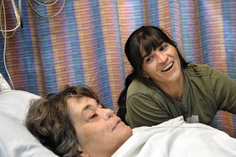 "Tami Layman, 42, right, stays with mother, Linda Hershey, in the surgical waiting area. Layman says her mother's ordeal has been a ""horrible, horrible thing for her to go through, but this has been some of the nicest times to be with her."" They haven't spent this much time together one-on-one for years, as Layman has 4 children. (Algerina Perna/Baltimore Sun/Sept. 28, 2010)"