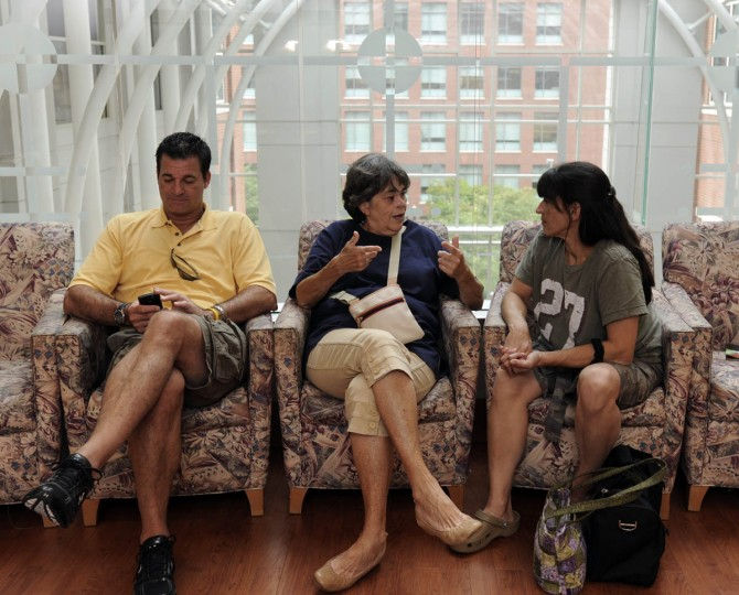 In the waiting room at Johns Hopkins Weinberg Cancer Center, Linda Hershey is flanked by her son, Scott Rogers, and daughter, Tami Layman before surgery to place donor rib cartilage as a support structure in her nose. (Algerina Perna/Baltimore Sun/Sept. 28, 2010)