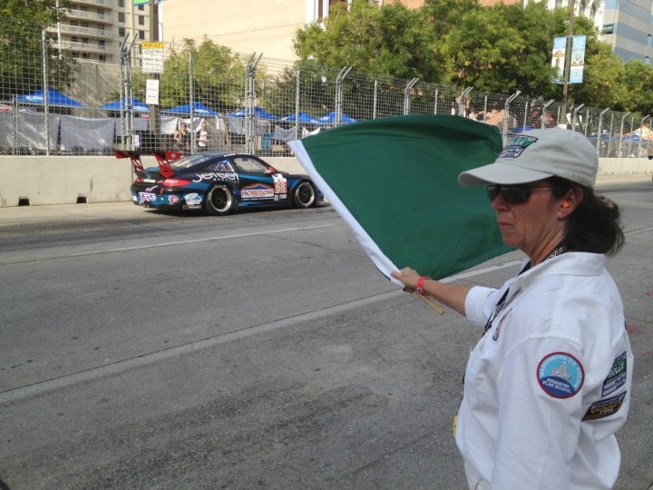 Cheryl Hasychak waves green flag at start of the ALMS Qualifier during the first day of the 2013 Grand Prix of Baltimore. (Karl Merton Ferron/Baltimore Sun)