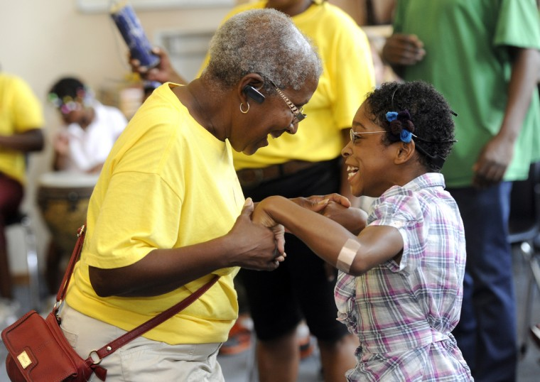 Arlene Dorsey, left, lead teacher, dances with Chanell Burrow, one of her students from the William S. Baer School who is participating in The Arc Baltimore Bay Buddies summer camp. The campers participated in a drum circle at the Living Classrooms, where the camp is based. (Barbara Haddock Taylor/Baltimore Sun)