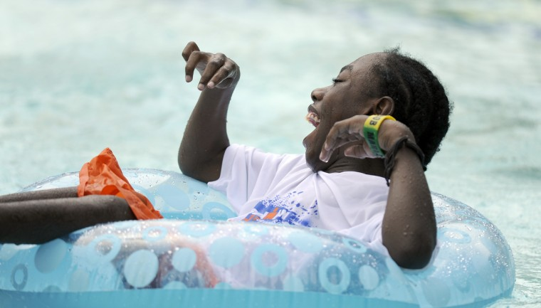 Terrence Ridley, 13, floats in a raft in Druid Hill Park pool. He and other students from the William S. Baer School are participating in The Arc Baltimore's Bay Buddies summer camp, where they enjoyed a day at the Druid Hill Park pool. (Barbara Haddock Taylor/Baltimore Sun)