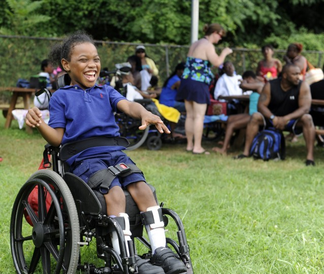 Calrod Smith, a nine-year-old student at the William S. Baer School who is participating in the Arc's Bay Buddies summer camp smiles after having a picnic lunch at the Druid Hill Park pool. (Barbara Haddock Taylor/Baltimore Sun)