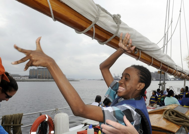 Abdul Little, 11, gets excited as he and other students from the William S. Baer School in Baltimore enjoy a ride aboard the skipjack Sigsbee, which is part of the Living Classrooms Foundation. The children are participating in the Bay Buddies summer camp program. (Barbara Haddock Taylor/Baltimore Sun)