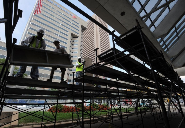 Workers set up the last grandstand on Pratt St. in front of the Baltimore Convention Center for the Grand Prix of Baltimore, which will be held Aug. 31 through Sept. 2. (Algerina Perna/Baltimore Sun)