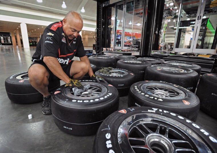 "Damon ""Camoose"" Lopez, a tire specialist with Team Penske, prepares racing tires on the final day of preparation before the running of the third Baltimore Grand Prix. The team, which features driver Will Power, the winner of the first Baltimore Grand Prix, and point leader Helio Castroneves, will prepare at least eight sets of tires per car for this weekend's racing. (Kenneth K. Lam/Baltimore Sun)"