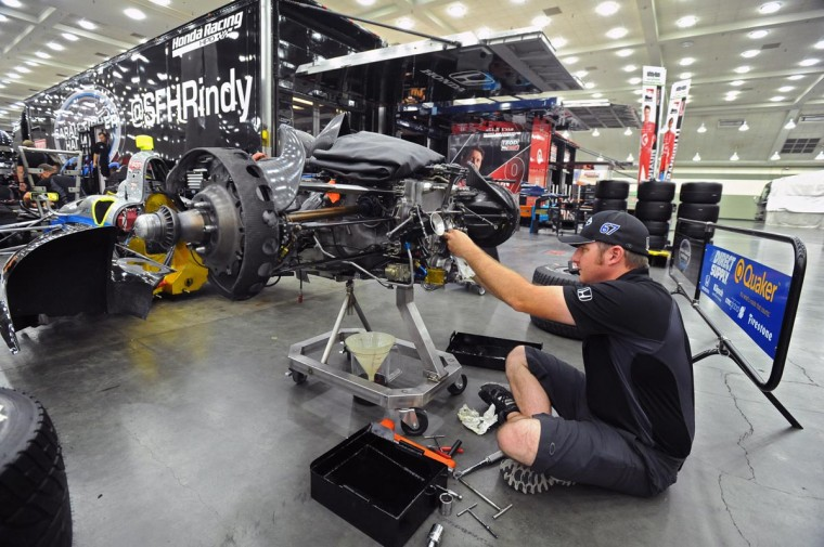 Jon Laski, gearbox mechanic for the Josef Newgarden car works on a spare transmission in the paddock area of the Baltimore Convention Center on the final day of preparation before the running of the third Baltimore Grand Prix. (Kenneth K. Lam/Baltimore Sun)