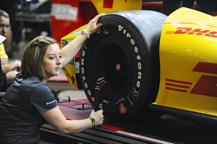 Inspector Amanda Senac measures the wheel base of the Ryan Hunter-Reay car during technical inspection of all Indycars before they start racing on the streets of Baltimore during the third Baltimore Grand Prix. (Kenneth K. Lam/Baltimore Sun)