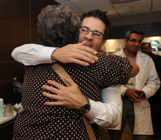 Dr. Patrick Byrne, and Linda Hershey, 67, hug each other after a follow-up appointment with him. (Algerina Perna/Baltimore Sun/Aug. 13, 2012)