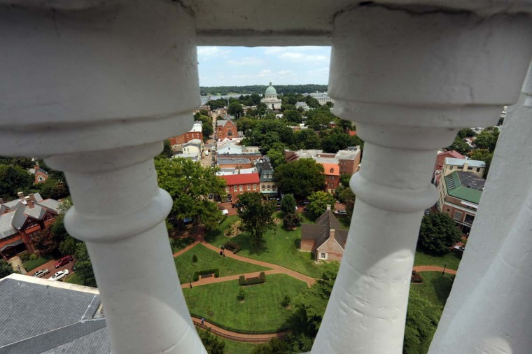 The Naval Academy Chapel dome can be seen in the distance from the porch outside the dome above the Maryland State House. Algerina Perna/Baltimore Sun