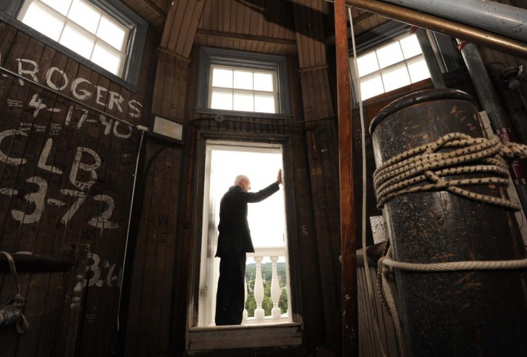 Sam Cook, director of the Annapolis Capitol Complex, stands at the threshold between the balcony and the dome above the Maryland State House. The signatures on the walls in this section of the dome are mostly from tourists. Algerina Perna/Baltimore Sun