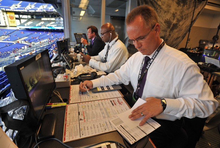 "Gerry Sandusky (front), Qadry Ismail (center) and Stan White prepare for the WBAL-TV/radio simulcast of the Ravens' preseason home opener against the Atlanta Falcons. ""I like to get here early and settle in, so that you can watch the day and night build and unfold,"" Sandusky says. (Amy Davis/Baltimore Sun Photo)"