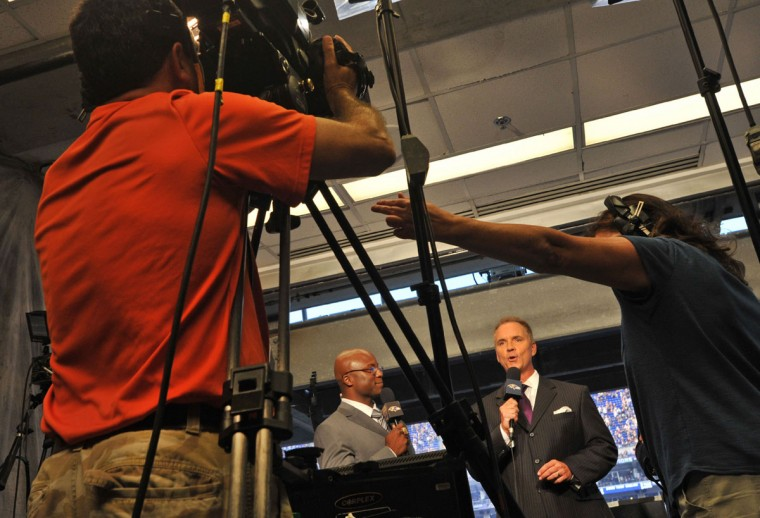 Gerry Sandusky (second from right) kicks off the simulcast as Qadry Ismail looks on. (Amy Davis/Baltimore Sun Photo)