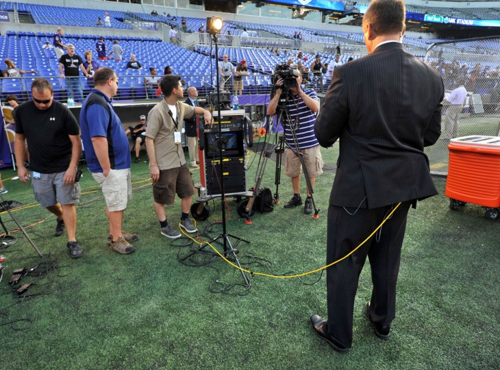 Gerry Sandusky is wired for a WBAL-TV report before the Ravens' preseason game against the Falcons. (Amy Davis/Baltimore Sun Photo)