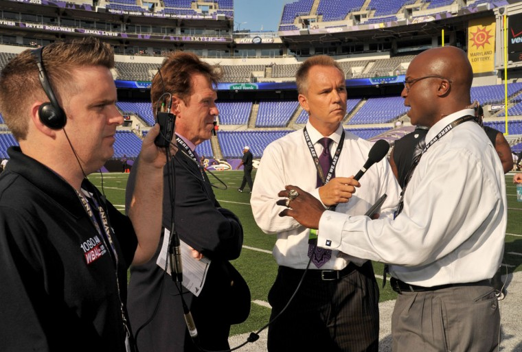 Johnny Goldsmith, left, listens to the audio as (from left) Stan White, Gerry Sandusky and Qadry Ismail record a WBAL radio segment before the game. (Amy Davis/Baltimore Sun Photo)