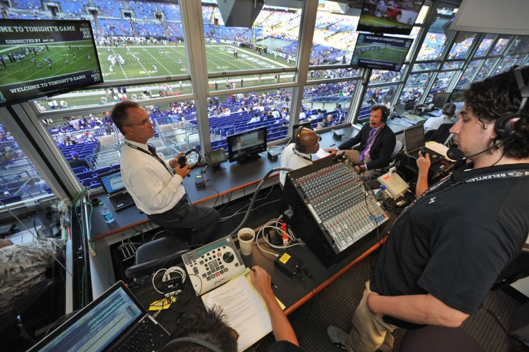 "Audio producer Mike Address (right) looks on Gerry Sandusky, Qadry Ismail and Stan White tape a pre-game show in the WBAL radio booth. Address, a partner in VPC Incorporated, describes producing a simulcast as ""controlled chaos."" (Amy Davis/Baltimore Sun Photo)"
