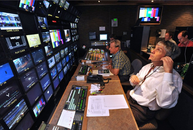 Don DiRaddo (front), the Ravens' director of broadcasting, is shown working in the main production truck during the game. (Amy Davis/Baltimore Sun Photo)