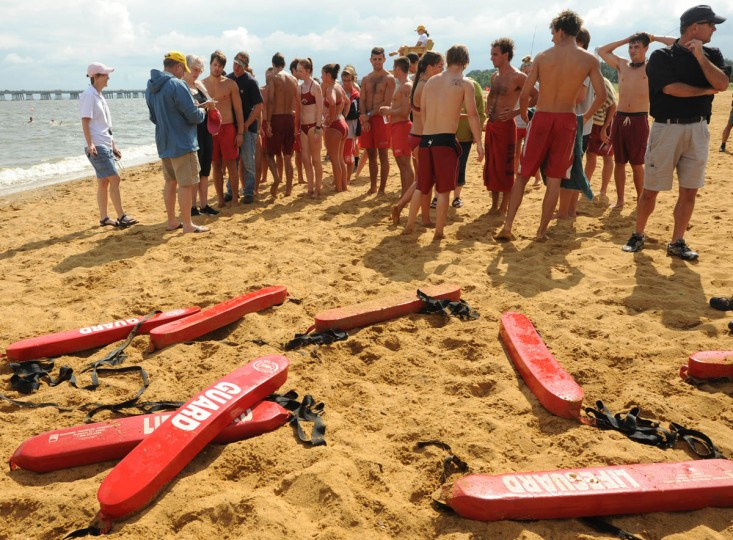After completing the water rescue, lifeguards wait for the next race, the Iron Guard. (Algerina Perna/Baltimore Sun)