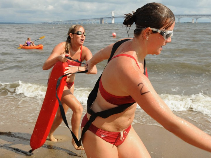 Rachel Allman, left, was rescued by Natalie Parks in the rescue competition. Both are lifeguards at Shad Landing Sate Park in Pocomoke. Sandy Point State Park hosts the Maryland Park Service Lifeguard Competition. Seventy-five lifeguards from around the state competed in swimming, running and rescue relays. (Algerina Perna/Baltimore Sun)