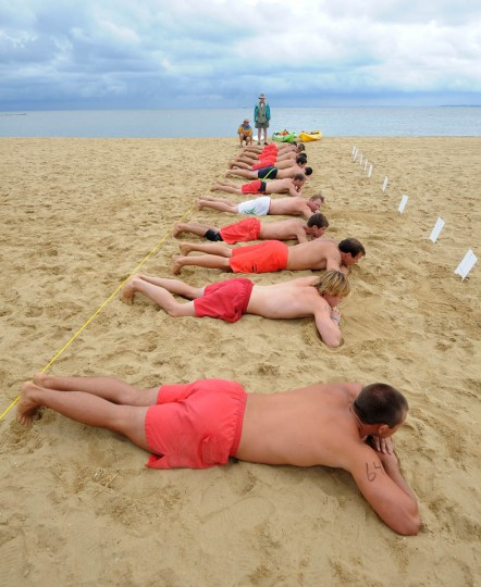 The lifeguards begin the Australian Sprint Elimination lying flat on their stomachs.(Algerina Perna/Baltimore Sun)