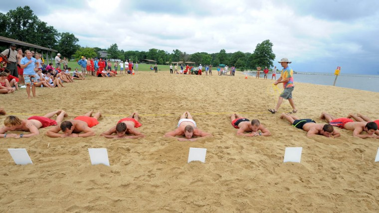 Cloudy skies didn't deter seventy-five lifeguards from around the state in competing in the Maryland Park Service Lifeguard Competition hosted by Sandy Point State Park. The lifeguards take part in the Australian Sprint Elimination (beach flags). (Algerina Perna/Baltimore Sun)