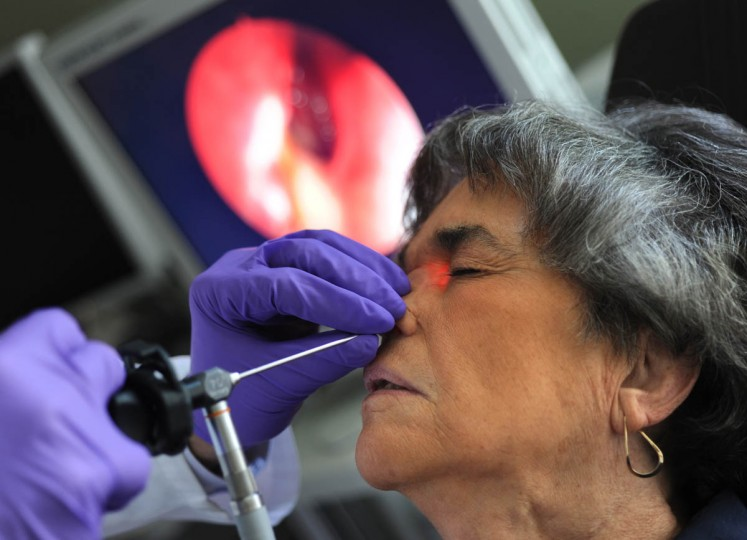 Douglas D. Reh, M.D., medical director, Johns Hopkins Otolaryngology-Head and Neck Surgery at Green Spring Station, examines Linda Hershey's right frontal sinus with an endoscope. Cancer was discovered in her frontal sinus in November, 2011. It was removed, but returned. (Algerina Perna/Baltimore Sun/July 26, 2012)