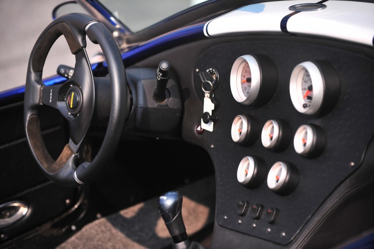 The carbon fiber shift lever, guages and the leather wrapped Momo steering wheel are shown in the interior of the 427 Roadster. (Gene Sweeney, Jr./Baltimore Sun)