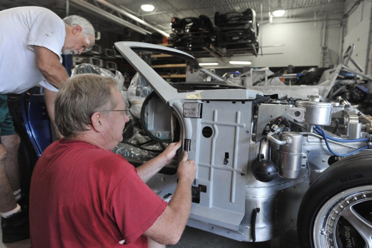 Randy Hubbert (left) and Steve Pranger work on a rare Series 1 car, with parts purchased from Shelby American, Inc. and assembled at FII Roadsters. Their primary creation is the 427 Roadster. (Gene Sweeney, Jr./Baltimore Sun)