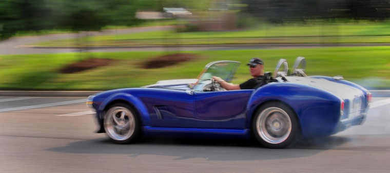 Bob Wingard takes a completed 427 Roadster for a spin in Crofton. Wingard, a NASA contractor responsible for unmanned, deep-space missions, built the car after having trouble finding a sports car that he could fit in. (Gene Sweeney, Jr./Baltimore Sun)