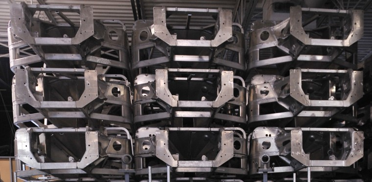 Bare aluminum frames are stacked up inside the warehouse/assembly building of FII Roadsters. (Gene Sweeney, Jr./Baltimore Sun)