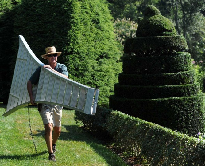 Ladew senior gardener Philip Krach gets ready for a day of trimming and sculpting some of the more than 100 topiaries in the 22 acres of gardens. Kim Hairston/The Baltimore Sun