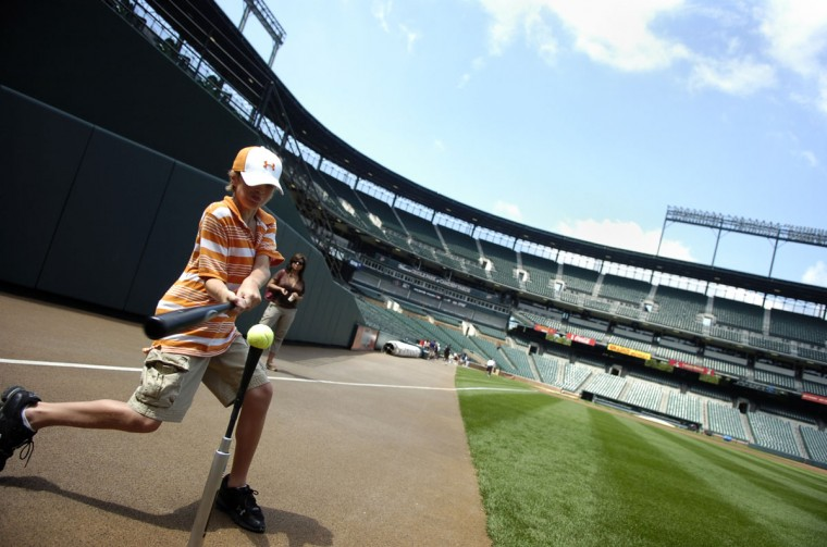While you're living a dream: Nick Merke, 11, practices hitting tennis balls during the Orioles' PLAY campaign to promote healthy living. (Gabe Dinsmoor/Baltimore Sun Photo)