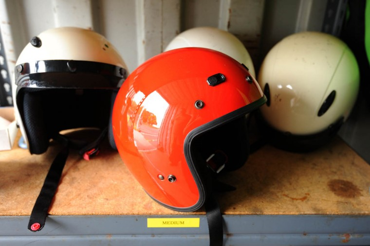 Spare helmets sit on a shelf in the trailor housing motorcycle gear. (Algerina Perna/Baltimore Sun)