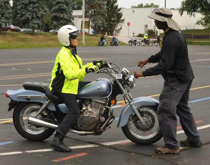 Mary Therese Pfau gets instruction from George Bess, Jr., who is on the Motorcycle Program Faculty. (Algerina Perna/Baltimore Sun)