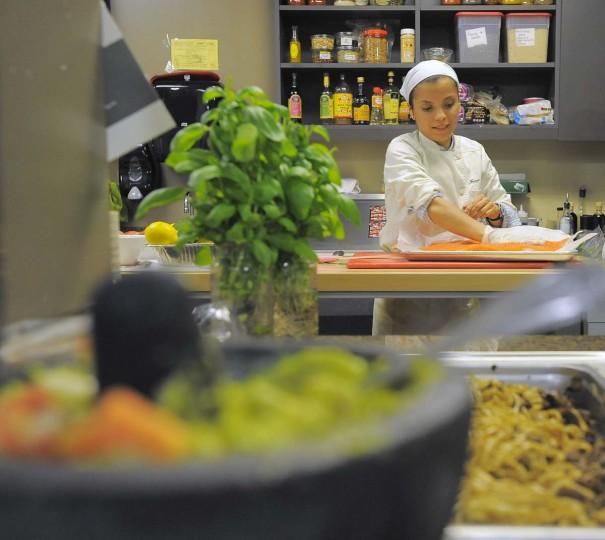 "Orioles chef Jenny Perez prepares a salmon filet. ""I think this is something everybody loves,"" Orioles slugger Chris Davis said of Perez's revamped menu. (Karl Merton Ferron/Baltimore Sun Photo)"