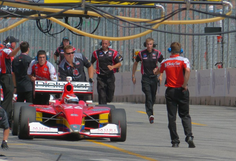 Pit crew for the no. 8 car runs to help the driver after the car stalled while leaving the pit lane during a qualifying race at the 2013 Grand Prix of Baltimore. (Karl Merton Ferron/Baltimore Sun Photo)