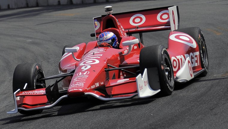 Scott Dixon navigates around Oriole Park heading into turn 9 during the 2013 Grand Prix of Baltimore. (Karl Merton Ferron/Baltimore Sun Photo)
