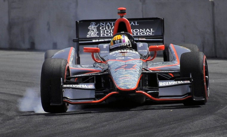Oriol Servia's car burns rubber as he heads into turn 9 during the 2013 Grand Prix of Baltimore (Karl Merton Ferron/Baltimore Sun Photo)