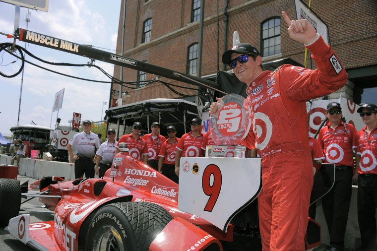 Scott Dixon's car sits in pit row as he celebrates getting the pole position for the IZOD IndyCar Series race during the 2013 Grand Prix of Baltimore. (Karl Merton Ferron/Baltimore Sun Staff)