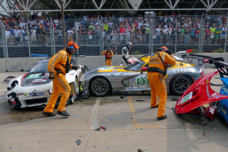 Clean-up of a major crash involving numerous race cars on the main straightaway on Pratt Street at the start of the ALMS Series Race. (Karl Merton Ferron / Baltimore Sun Staff)