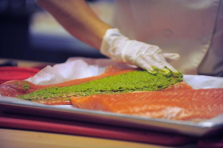 A close-up photo of chef Jenny Perez preparing a salmon filet. (Karl Merton Ferron/Baltimore Sun Photo)