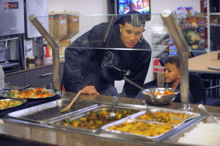 Orioles third baseman Manny Machado and his nephew, J.J. Godoy, look over the clubhouse buffet offerings on a recent game day at Camden Yards. (Karl Merton Ferron/Baltimore Sun Photo)