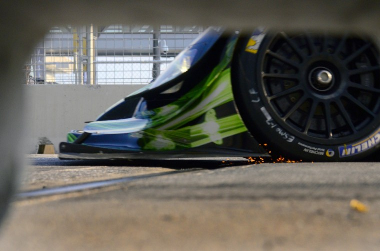 The P2 Patron car 02 with Extreme Speed Motorsports kicks up sparks as it hits the light rail track on Pratt Street during the 2013 Grand Prix of Baltimore Friday, Aug. 30, 2013. (Karl Merton Ferron/Baltimore Sun)