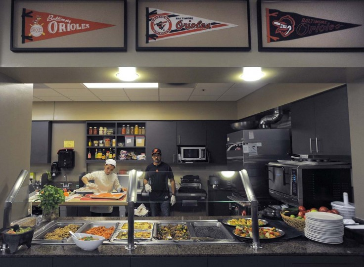 Chef Jenny Perez (left) and Carlos Cruz prepare food for the Orioles in the clubhouse kitchen. Perez started working in the Orioles' kitchen in June after being hired by vice president of baseball operations Brady Anderson, who was seeking more healthy food options for the team. (Karl Merton Ferron/Baltimore Sun Photo)