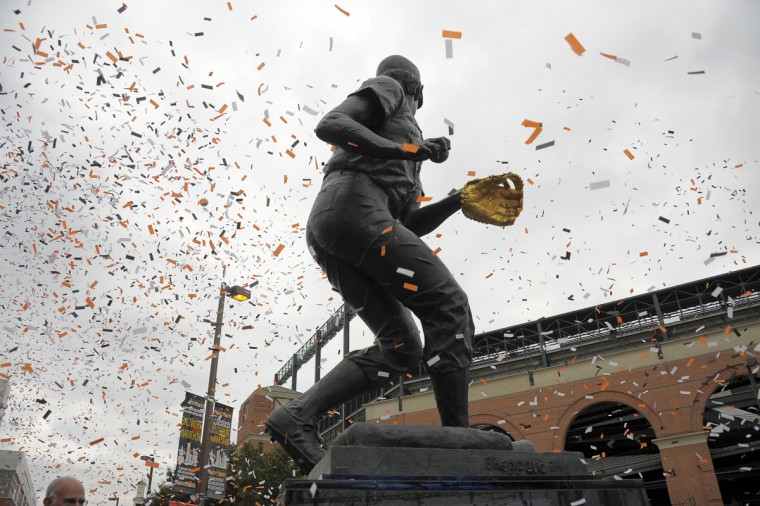 As a legend: Confetti flies during the unveiling of a statue honoring Orioles third baseman and Hall of Famer Brooks Robinson at the plaza in front of Pickles Pub, in the shadow of Oriole Park at Camden Yards on Saturday, Oct. 22, 2011. (Karl Merton Ferron/Baltimore Sun Photo)