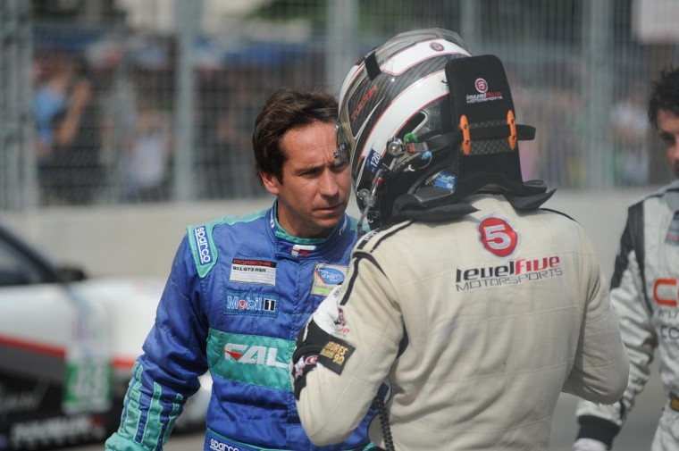 ALMS drivers talk after a massive pileup at the start of the ALMS race. (Jerry Jackson/Baltimore Sun)